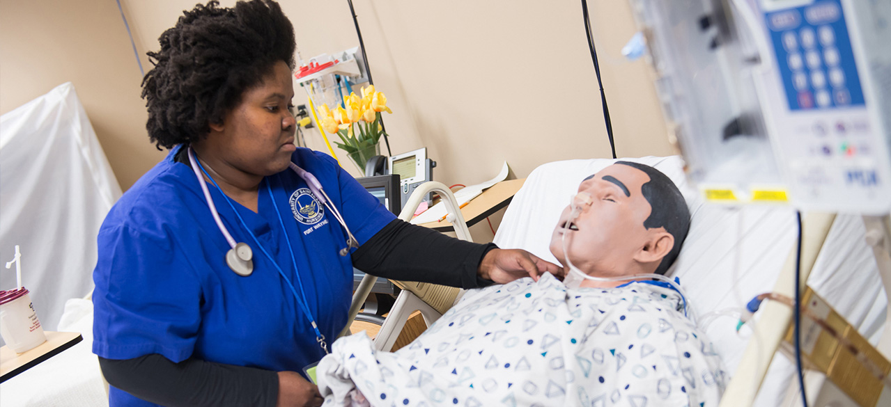 USF Crown Point Nursing Student working with a patient simulator